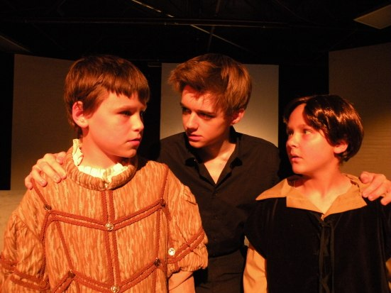 Hamlet lectures Rosencrantz & Guildenstern: Jaxon Beeson, Chris Rodenbaugh, Kennedy Waterman