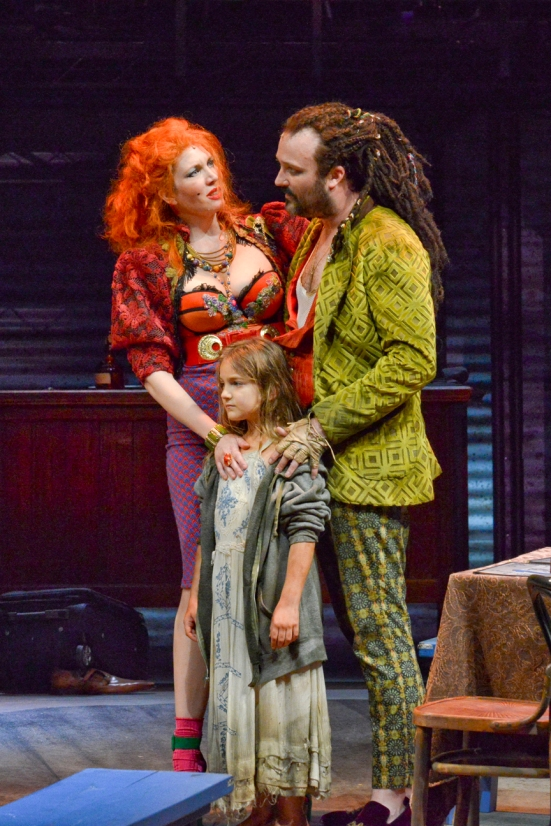 CHRISTIA MANTZKE and STEVEN MICHAEL WALTERS as the Thenardiers. JEMMA KOSANKE as Cosette