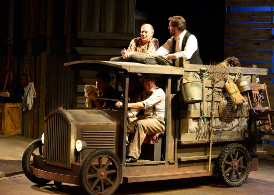 En route to California: Michael Corolla, Erik Schark (standing), Cameron Cobb (driving)