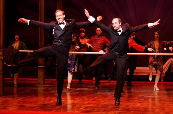 Christopher J. Deaton as The Baron, dancing with Andy Baldwin as Otto Kringelein
